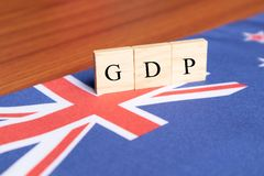 Gross Domestic product or GDP of Australia In wooden block letters on Australian Flag stock photography