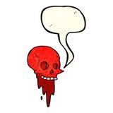 Gross halloween skull cartoon with speech bubble Royalty Free Stock Image