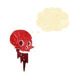 Gross halloween skull cartoon with thought bubble Stock Photo