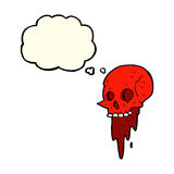 Gross halloween skull cartoon with thought bubble Stock Images