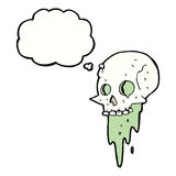 Gross halloween skull cartoon with thought bubble royalty free illustration