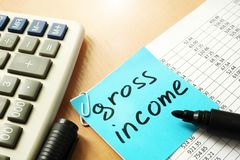 Gross income written on a stick.