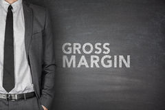 Gross margin on blackboard Royalty Free Stock Images