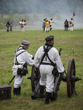 Grossbeeren-2012-Kanone-Soldaten. Grossbeeren, Teltow-Flaming, Brandenburg, Germany, August 2012: reenactment of the historical battle against the French troops royalty free stock photography