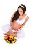 Grossesse, santé et beauté Vitamines et fruit pour les femmes enceintes Photographie stock