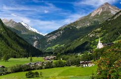 Grossglockner in Austria, European Alps. Rural landscape of Heiligenblut, North Tyrol, highest mountain from Austria in background, Grossglockner (3797 m Royalty Free Stock Photo