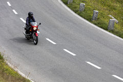 Grossglockner, Austria, 23 July 2015: Alpine road, motorbike speeding, Eastern Alps Royalty Free Stock Photos
