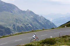 Grossglockner, Austria, 23 July 2015: Cyclist on uphill road, Ea Stock Photo