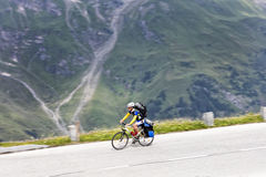 Grossglockner, Austria, 23 July 2015: Cyclist on uphill road, Ea Stock Photography