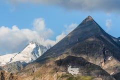 Grossglockner in wolken, Nationaal Park Hohe Tauern, Oostenrijk Stock Afbeeldingen