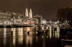 Grossmünster with Limmat river by night Stock Photography