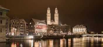 Grossmünster with Limmat river by night Royalty Free Stock Photo