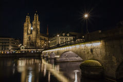 Grossmunster Church and Zurich Downtown at night Royalty Free Stock Photos