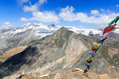 Grossvenediger south face and Prayer flag, Hohe Tauern Alps, Austria Royalty Free Stock Photo