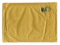 Grote bruine envelop met eerste klassenzegels Stock Afbeelding