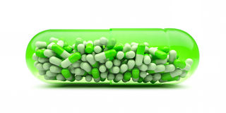 Grote capsule met kleine capsules. Stock Afbeeldingen