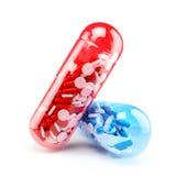 Grote capsules met verschillende kleuren van kleine capsul Royalty-vrije Stock Afbeeldingen