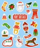 Grote die Kerstmisstickers op blauwe achtergrond worden geplaatst Royalty-vrije Stock Foto's