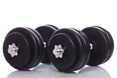 Grote dumbells over witte achtergrond Stock Foto's