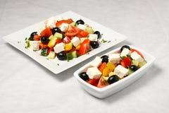 Grote en kleine salade Stock Fotografie