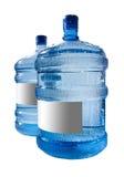 Grote fles water dat op een witte achtergrond wordt geïsoleerdt Stock Foto's