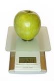 Grote groene appel op elektronisch Stock Foto's