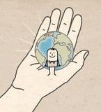 Grote hand - Aarde en mens Stock Foto's