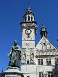 Grote Markt, Aalst, Belgium. A view of the belfry and statue of Dirk Martens which stand on the main market place in Aalst, a town in East Flanders, Belgium Royalty Free Stock Images