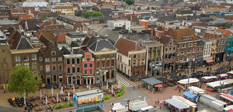 Grote Markt Groningen. Grote Markt is the city center of Groningen, The Netherlands. The view of a row of pubs was taken from Martini tower. The square is busy Stock Image