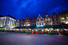 Grote Markt square with market at night in Bruges Royalty Free Stock Image