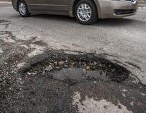 Grote pothole in weg royalty-vrije stock foto