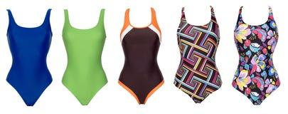 Grote reeks ééndelige zwempakken van verschillende kleur royalty-vrije stock afbeeldingen