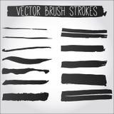 Grote reeks slagen van de grungeborstel. Inzameling van zwarte vectorinkt Stock Afbeelding