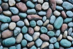 Grote steenmuur Steentextuur met verschillende kleuren stock afbeelding