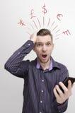 Grote telefoonrekening, met grafische hoofdwereldmunten royalty-vrije stock foto's