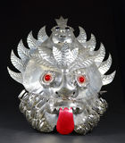 Grotesque Aztec Mask. Sheet metal tin mask made by Mexican craftsmen 35+ years ago with added color to the eyes and tongue Royalty Free Stock Photos