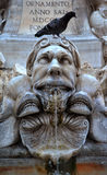 Grotesque marble head with fountain Royalty Free Stock Image