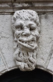 Grotesque monster head in Venice. Old marble sculpture of a monster outside Santa Formosa Church belfry in Venice (17th century Stock Images