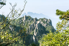 Grotesque peaks thrusts itself towards the sky. This photo was taken in West Seashore park,Mt. Sanqingshan.Photo taken on:Oct 21th,2015.Mt. Sanqingshan, located Stock Photos