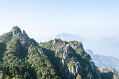 Grotesque peaks thrusts itself towards the sky. This photo was taken in West Seashore park,Mt. Sanqingshan.Photo taken on:Oct 21th,2015.Mt. Sanqingshan, located Royalty Free Stock Photos