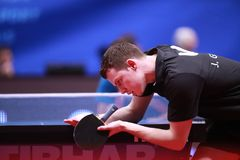 GROTH Jonathan from Denmark on serve. Montreux, Switzerland, 3 February 2018.First Round at the ITTF European Top 16 Royalty Free Stock Photos