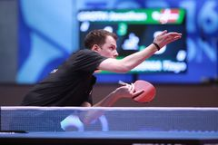GROTH Jonathan from Denmark on serve. Montreux, Switzerland, 3 February 2018.First Round at the ITTF European Top 16 Royalty Free Stock Photo