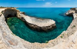 Grotta del Canale, Sant`Andrea, Salento sea coast, Italy. Picturesque seascape with white rocky cliffs, caves, sea bay and islets at Grotta del Canale, Sant` royalty free stock image