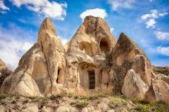 Grottabosättningar i Cappadocia, Turkiet royaltyfri foto