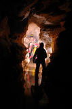grottacavers som undersöker gallerit Fotografering för Bildbyråer
