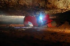 Grottapassage med en spelunker Royaltyfria Bilder