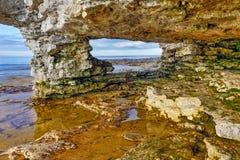 Grottapunkt vaggar bågen Arkivfoto