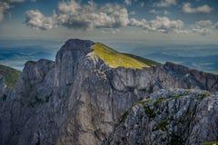 grottastadseskien kermen den slags bergkanten Arkivfoton