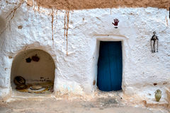 Grottmänniskahus Arkivbild