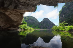 From the grotto. Beautiful view on the mountain from the grotto. Tam coc national park. Vietnam stock photos